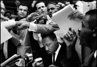 USA. Birmingham, Alabama. 1962. Reverend Martin Luther KING at a press conference. Contact email: New York : photography@magnumphotos.com Paris : magnum@magnumphotos.fr London : magnum@magnumphotos.co.uk Tokyo : tokyo@magnumphotos.co.jp Contact phones: New York : +1 212 929 6000 Paris: + 33 1 53 42 50 00 London: + 44 20 7490 1771 Tokyo: + 81 3 3219 0771 Image URL: http://www.magnumphotos.com/Archive/C.aspx?VP=Mod_ViewBoxInsertion.ViewBoxInsertion_VPage&R=2S5RYD1RVS1K&RP=Mod_ViewBox.ViewBoxZoom_VPage&CT=Image&SP=Image&IT=ImageZoom01&DTTM=Image&SAKL=T